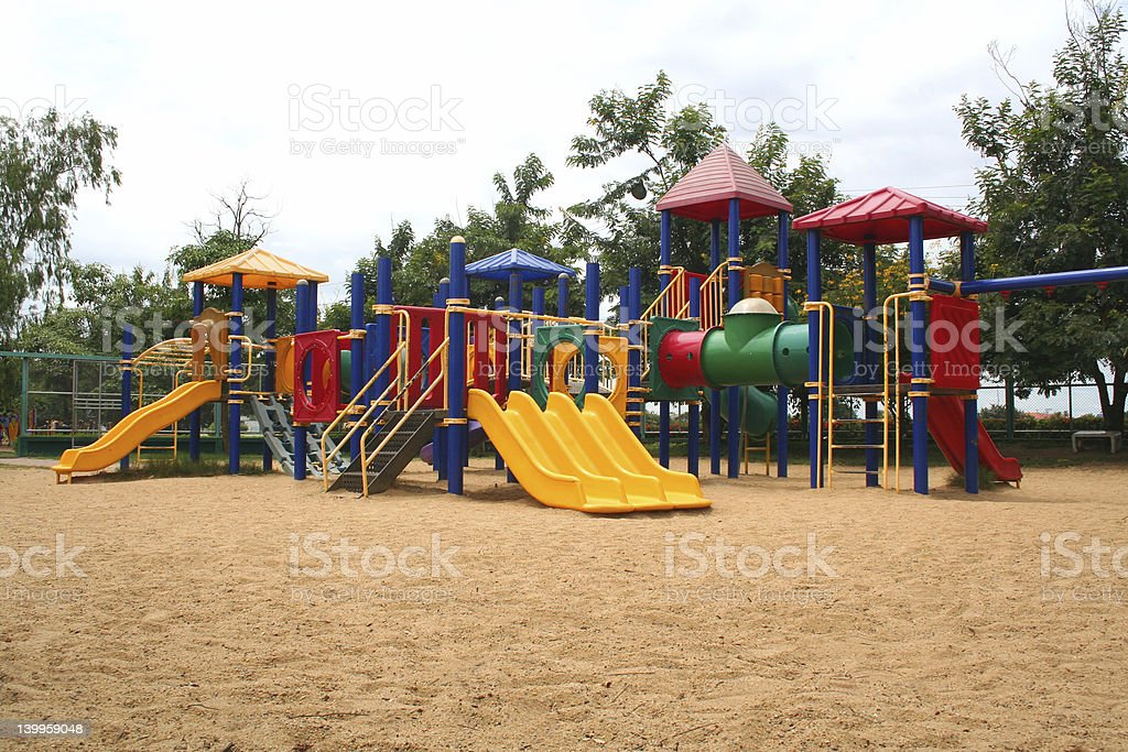 Playground with colorful equipment on sand stock photo