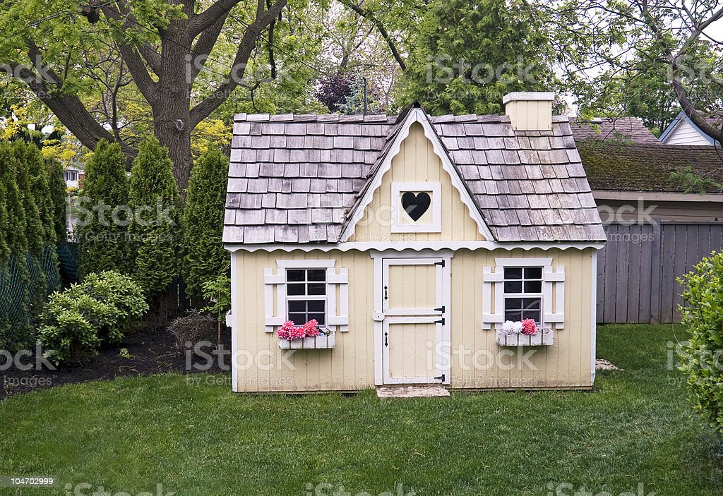 Playhouse in the yard stock photo