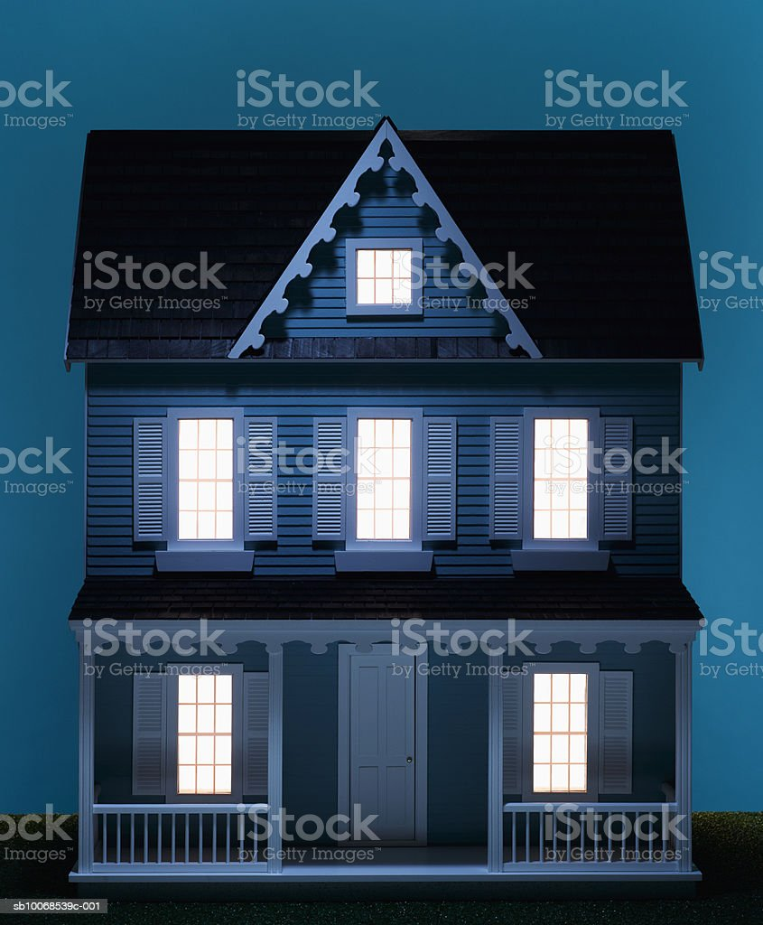Playhouse with illuminated windows, close-up royalty free stockfoto