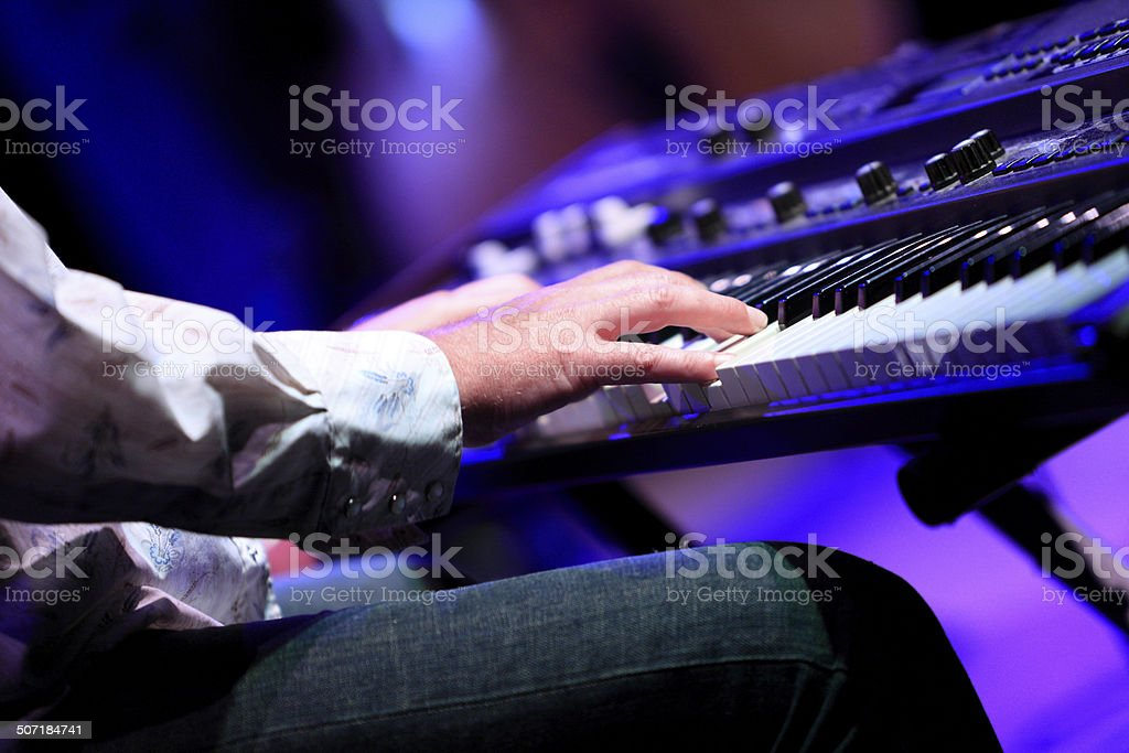 Playin' the blues on keyboard stock photo