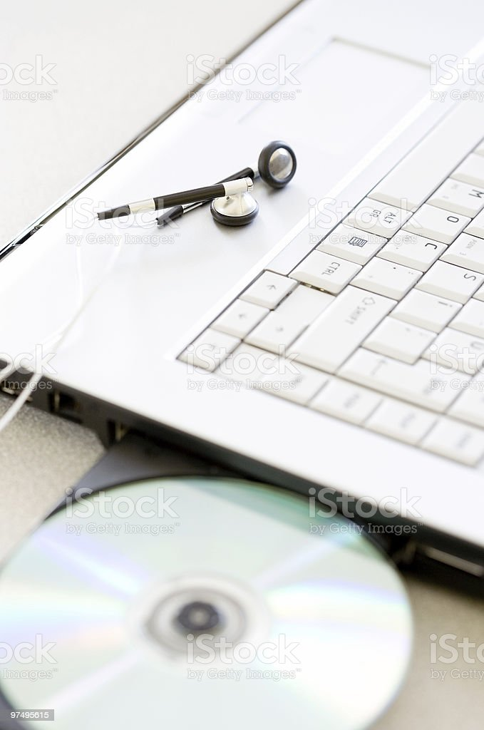 Playing a CD on Laptop royalty-free stock photo