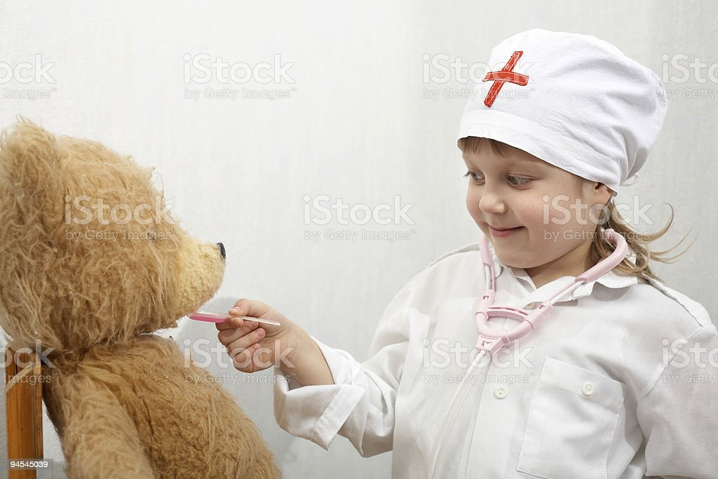 Playing a doctor royalty-free stock photo