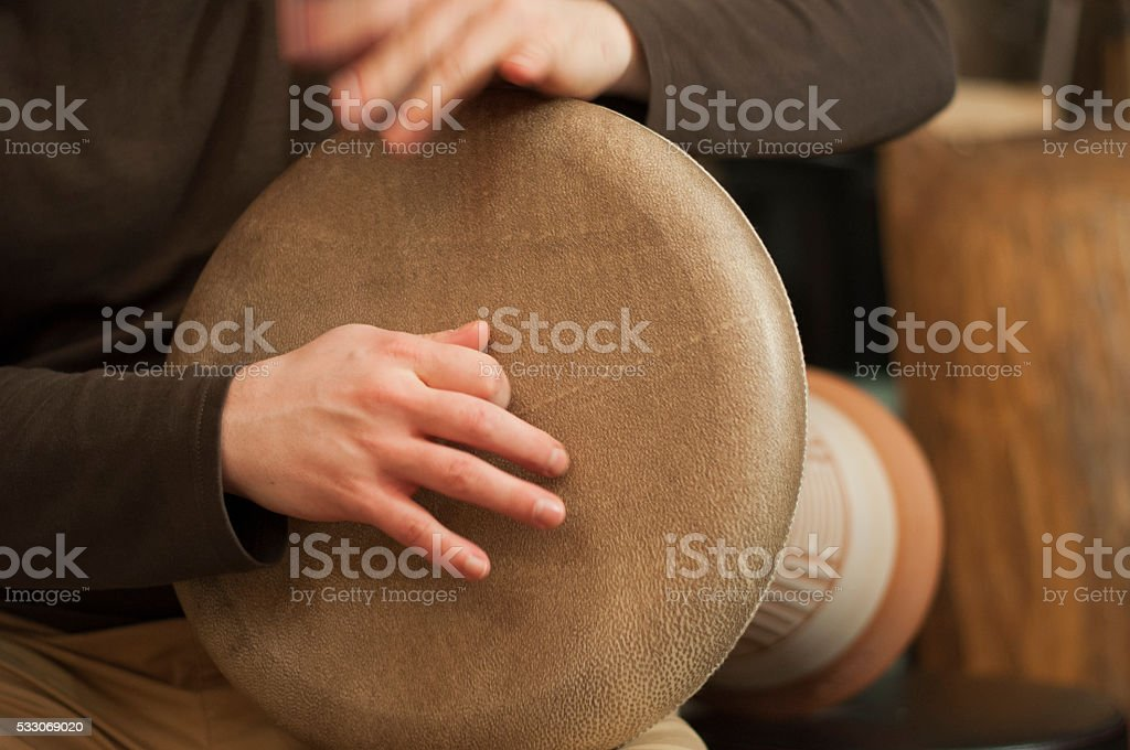 Playing a drum. stock photo