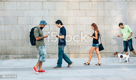 istock Playing a game on the phone 587231216