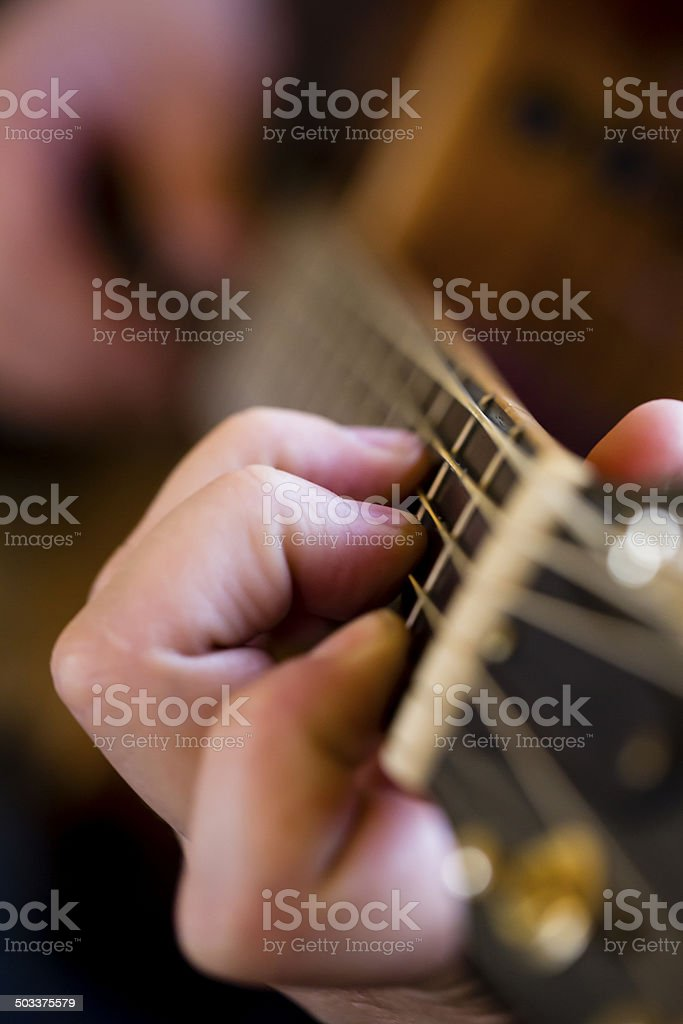 Playing a Guitar Chord stock photo
