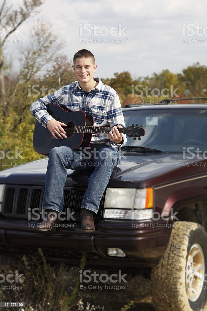 Playing a guitar out in the country. royalty-free stock photo
