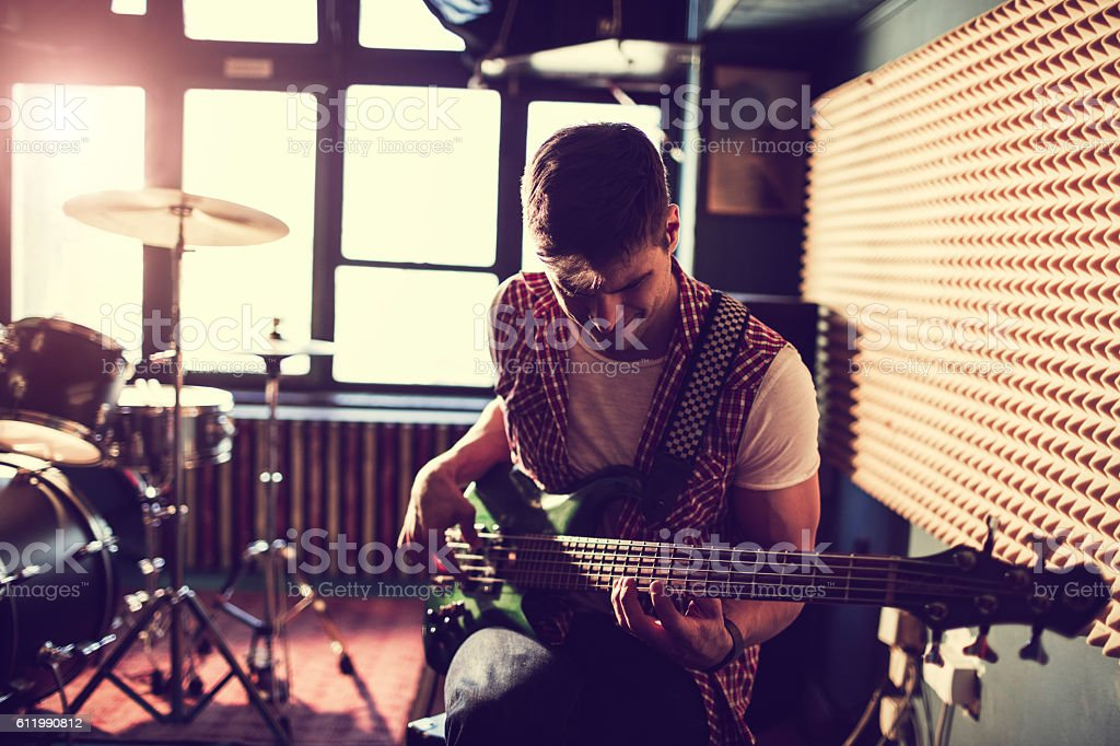 Playing a guitar royalty-free stock photo
