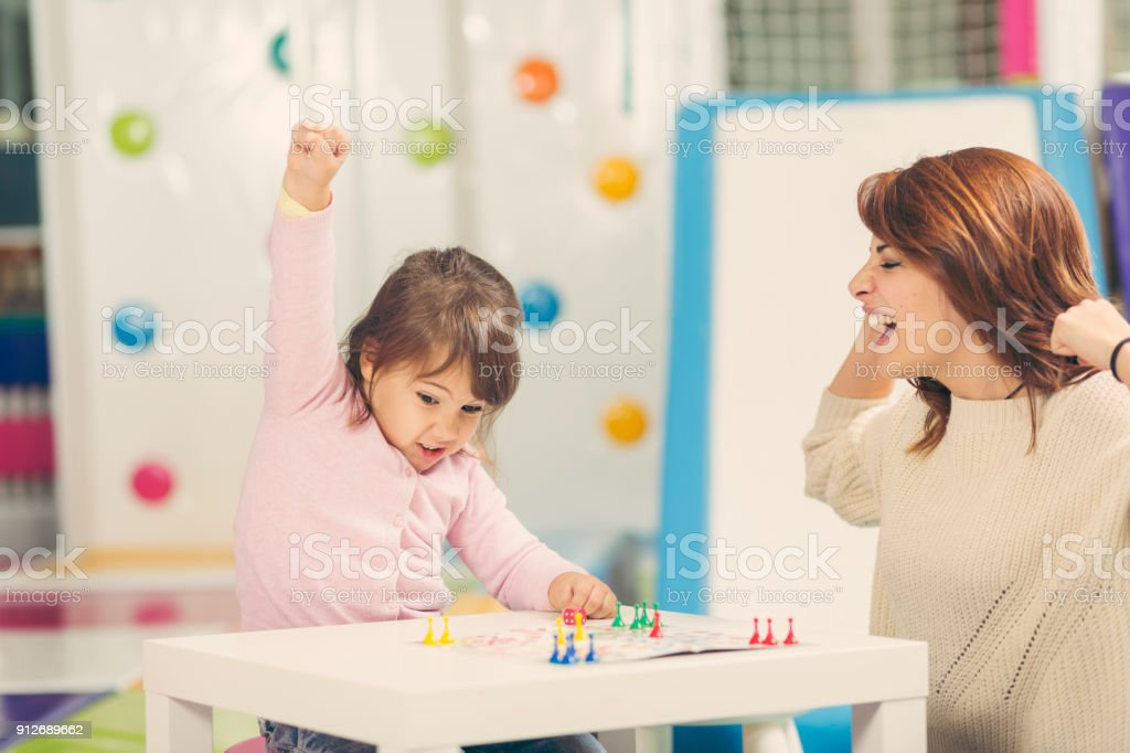 Playing a ludo game stock photo