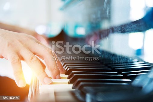 Man hand playing a piano.
