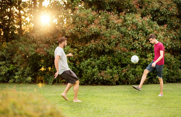 Playing a quick game of soccer stock photo
