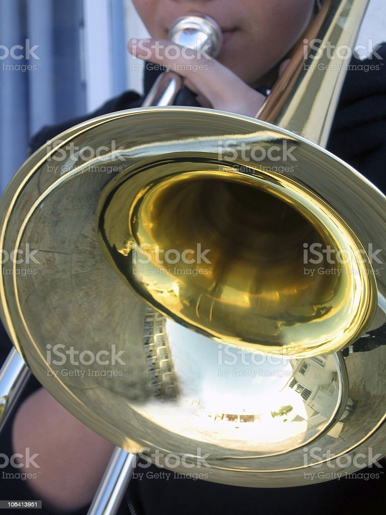 playing a trombone royalty-free stock photo
