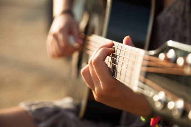 Playing acoustic guitar close-up stock photo