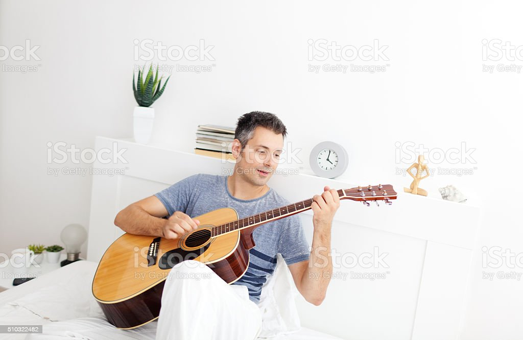 Playing acoustic guitar royalty-free stock photo