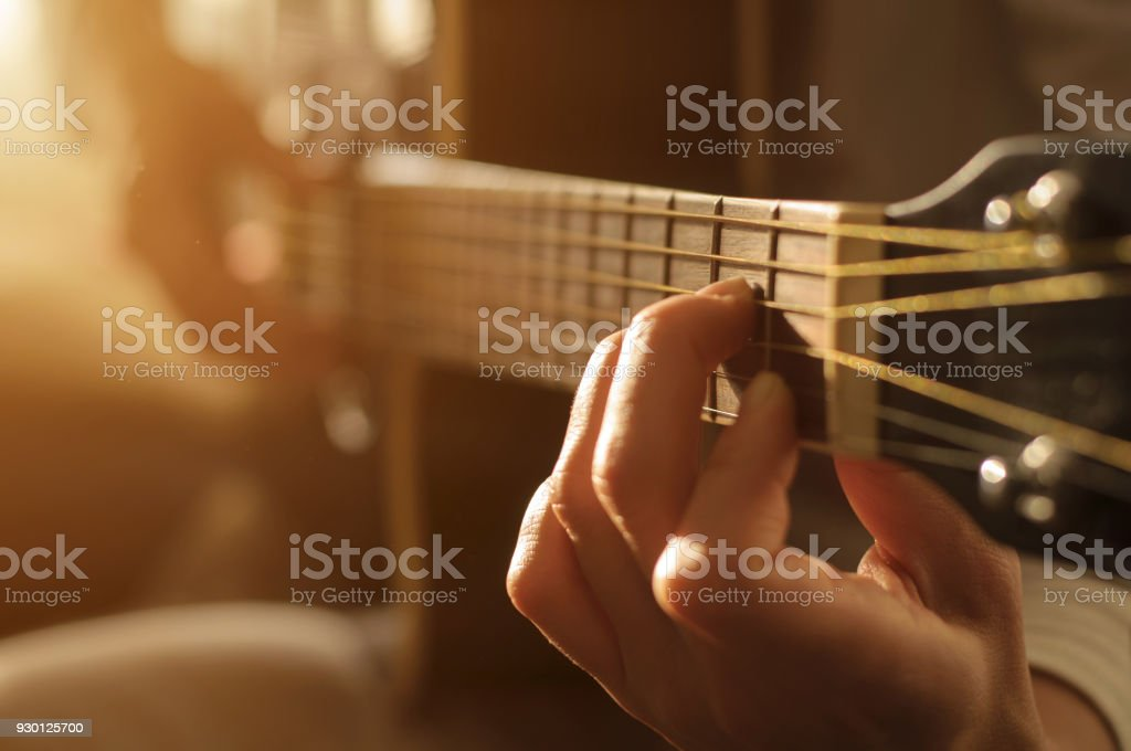 playing acoustic guitar stock photo