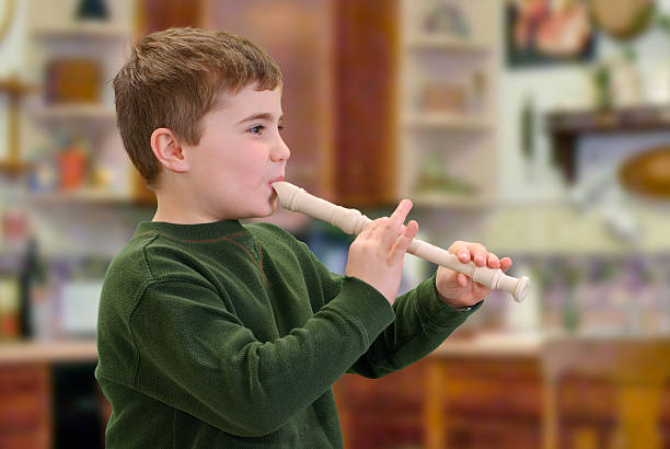 playing an instrument - recorder stock photos and pictures