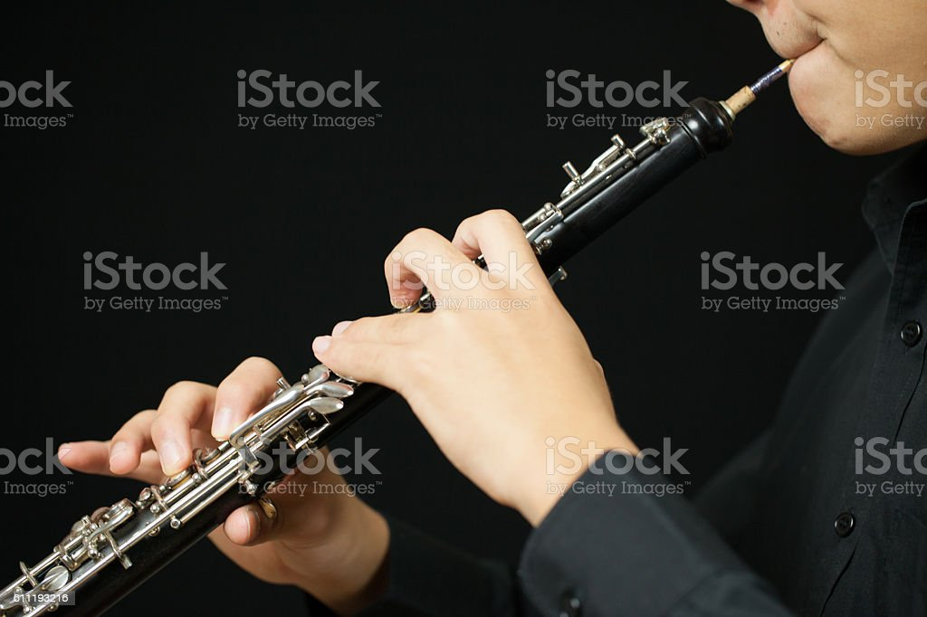 Playing an Oboe stock photo
