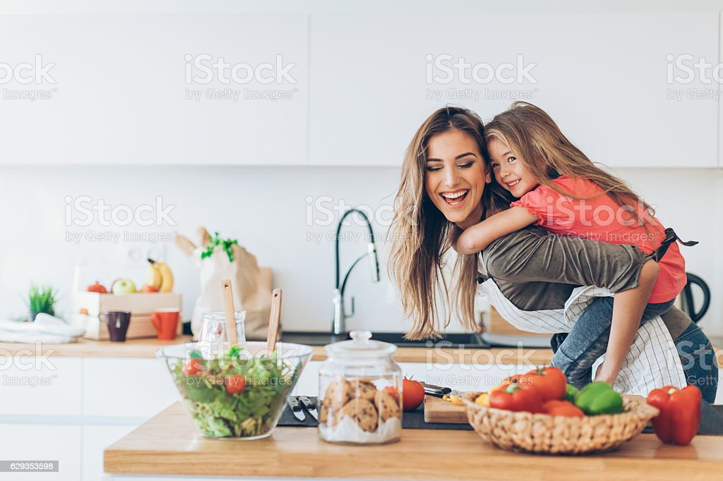 Playing and cooking stock photo