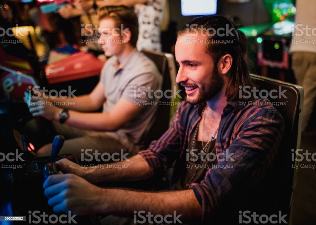 Playing Arcade Driving Games stock photo