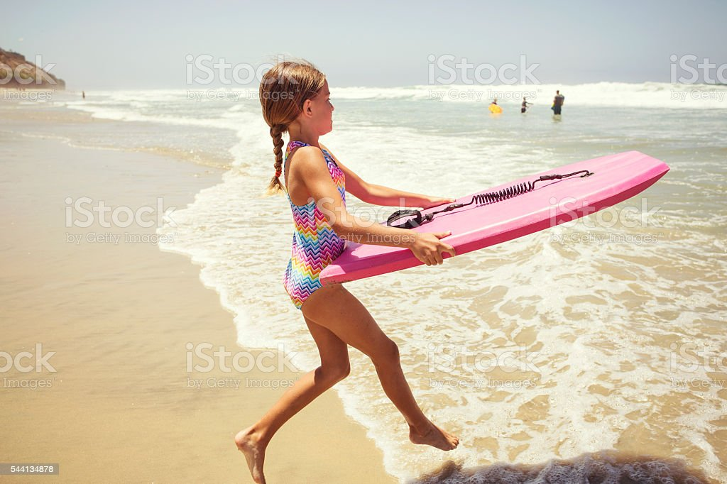 Playing at the beach on summer vacation stock photo