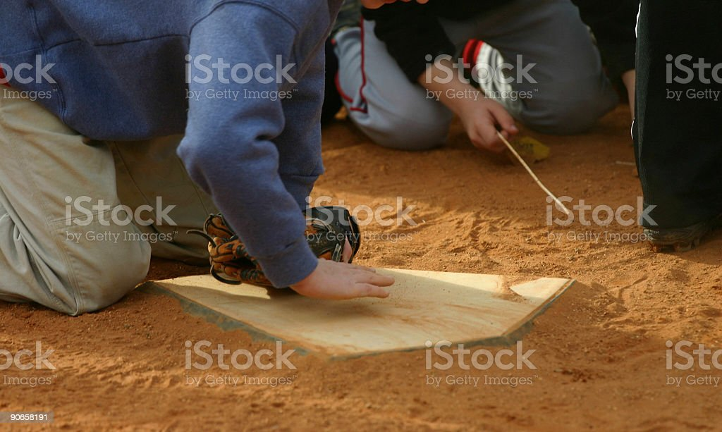 Playing at the Plate stock photo