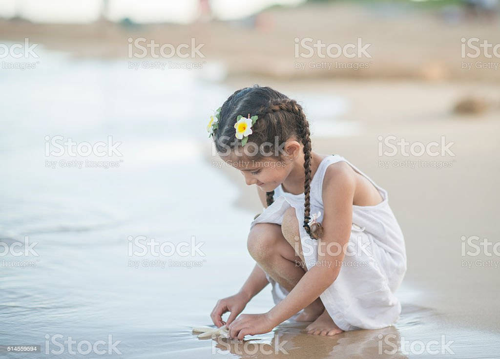 Playing at the Waters Edge stock photo