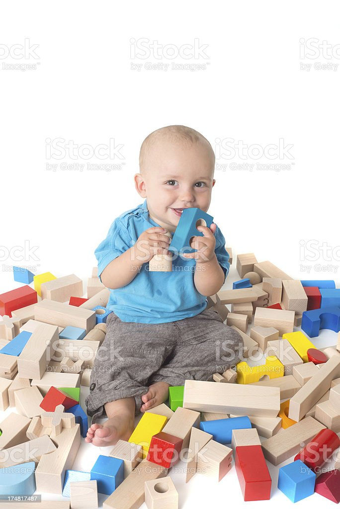 playing Baby with heltyh bio log of woods and smiling stock photo