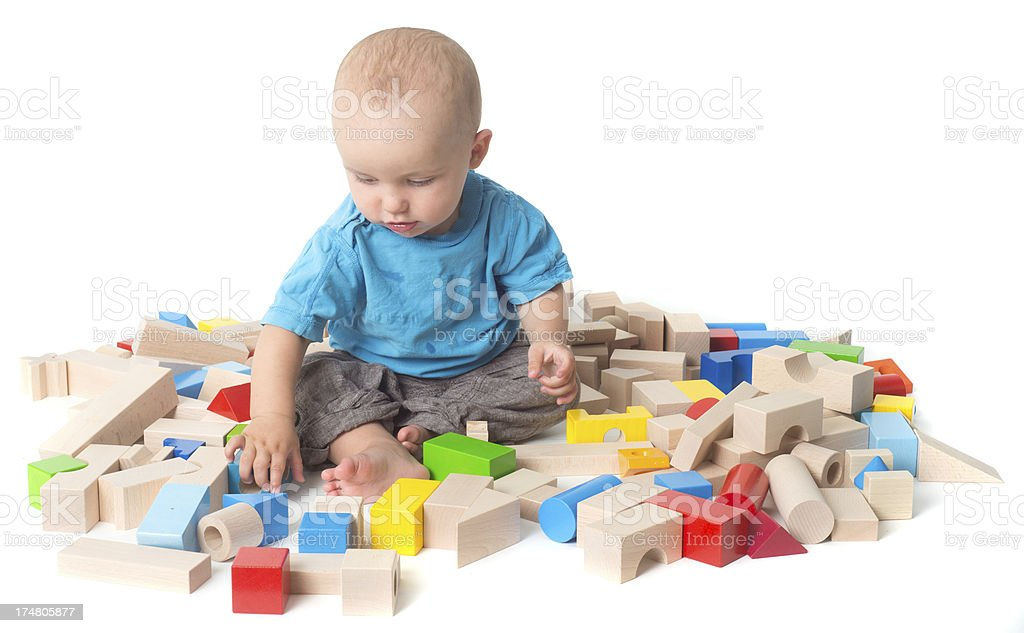 playing Baby with log of woods in studio seeking stock photo