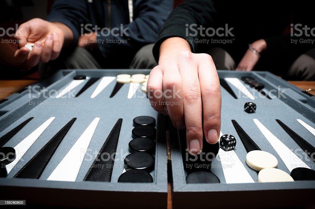 Playing backgammon stock photo