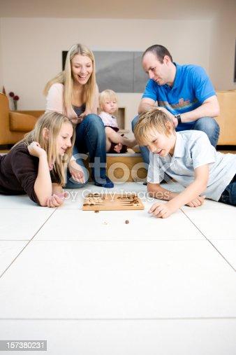172407626istockphoto playing backgammon 157380231