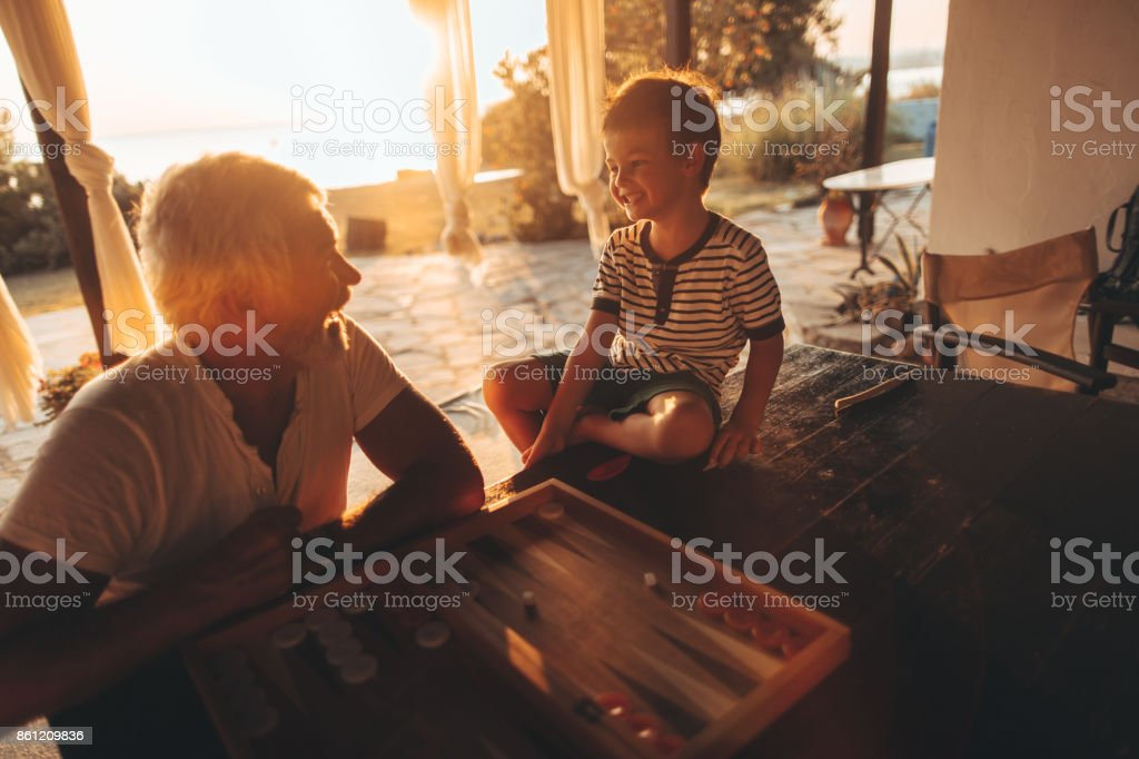 Playing backgammon together stock photo