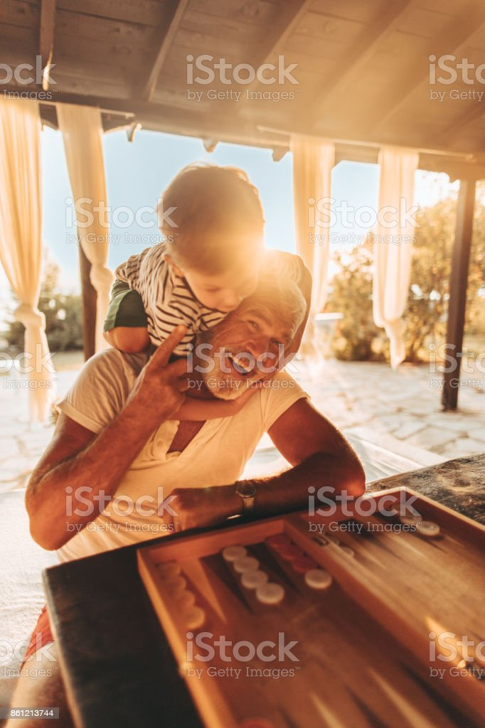 Playing backgammon with my grandson stock photo