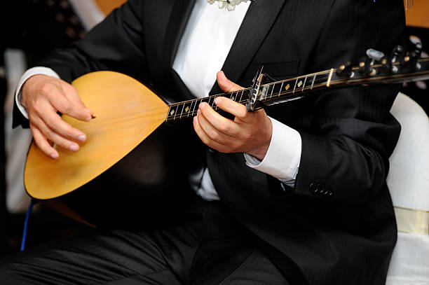 Playing Baglama stock photo