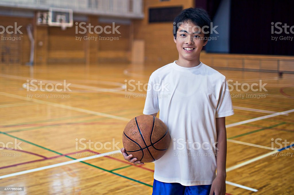 Playing basketball in the school gymnasium stock photo