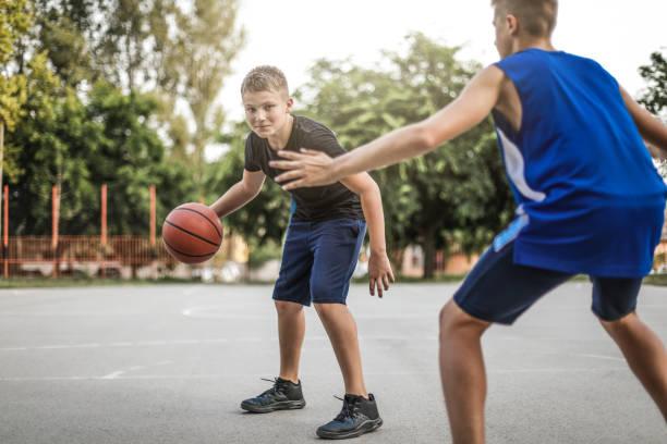 Playing Basketball Outdoors stock photo
