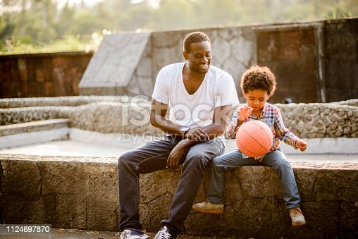 889172928istockphoto Playing basketball 1124697870
