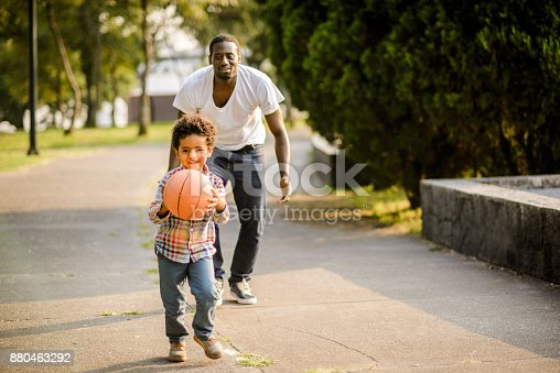 889172928istockphoto Playing basketball. 880463292