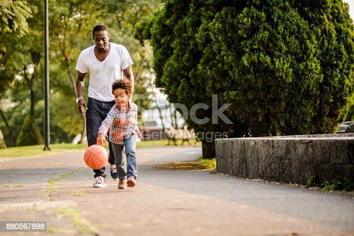 889172928istockphoto Playing basketball. 880567898