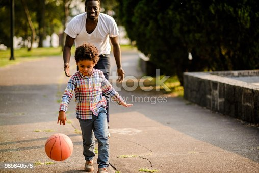 889172928istockphoto Playing basketball. 985640578