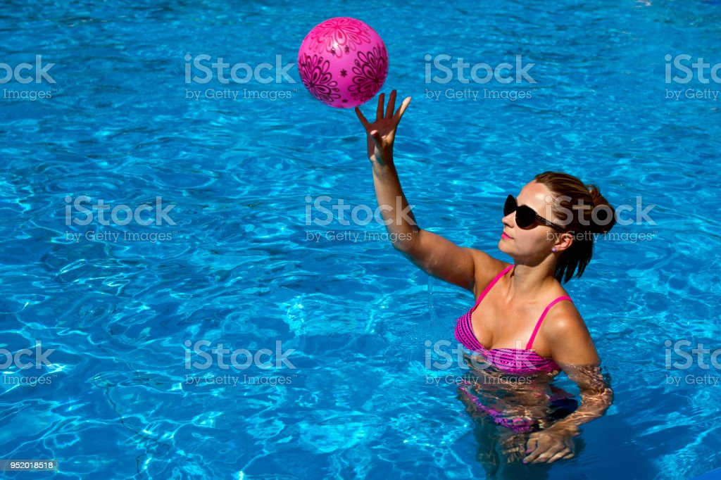 Playing Beach Ball In The Swimming Pool Stock Photo & More ...