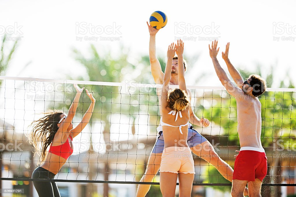 Playing beach volleyball. stock photo