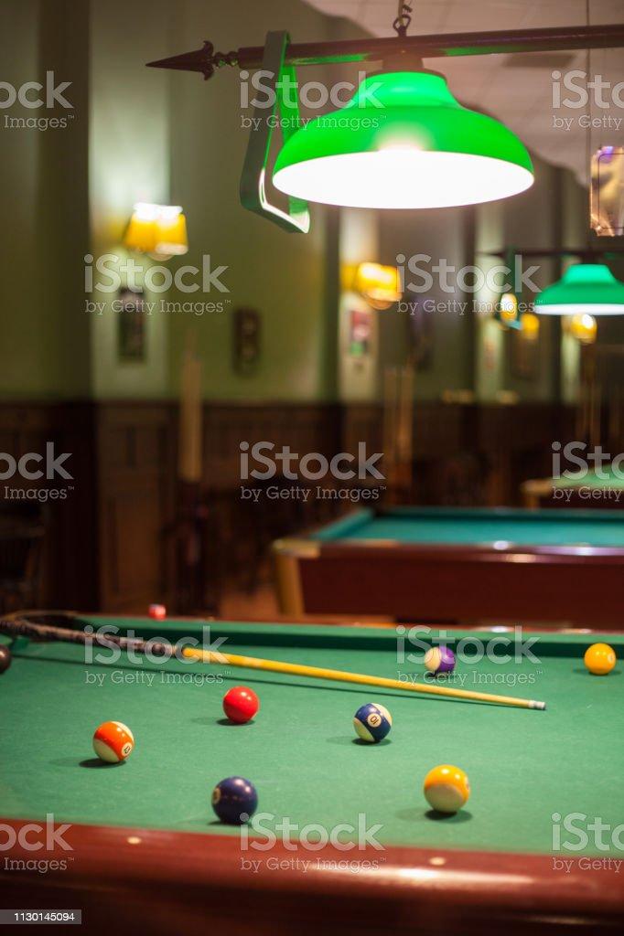 Playing billards, billard ball and billard cue stock photo