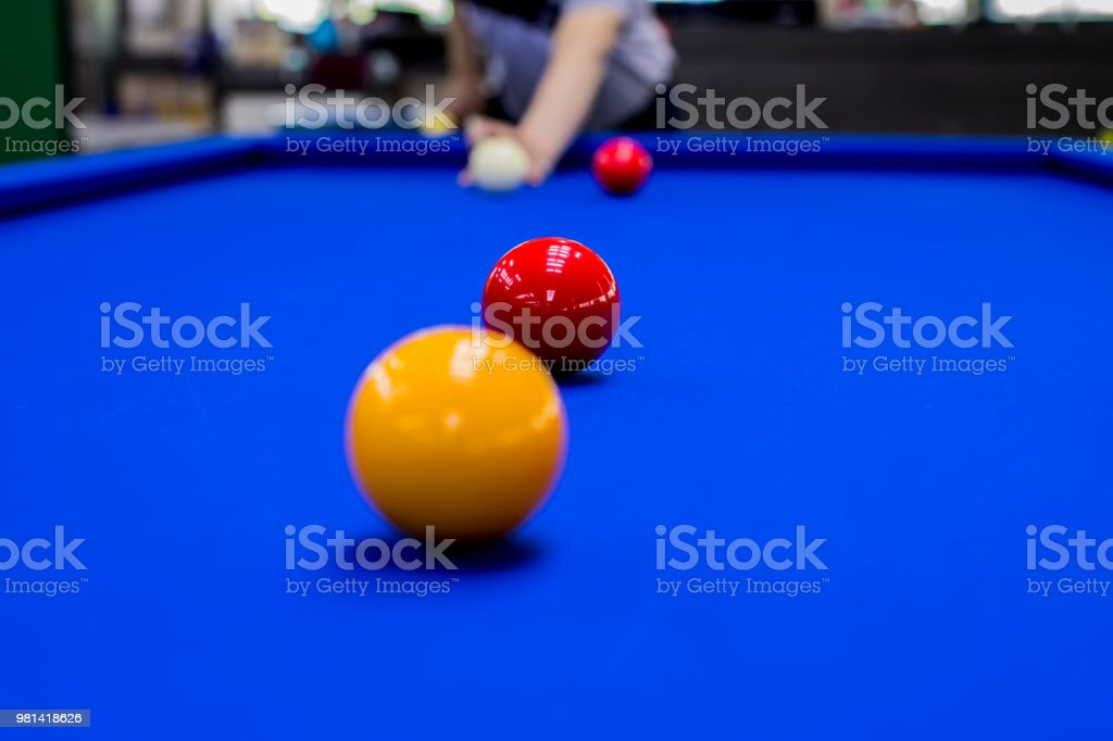 Playing billiard. Player hits ball with cue - fotografia de stock