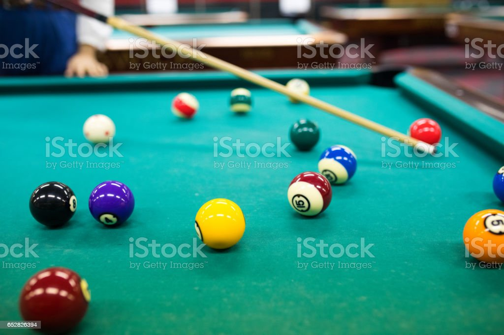 Playing billiards stock photo