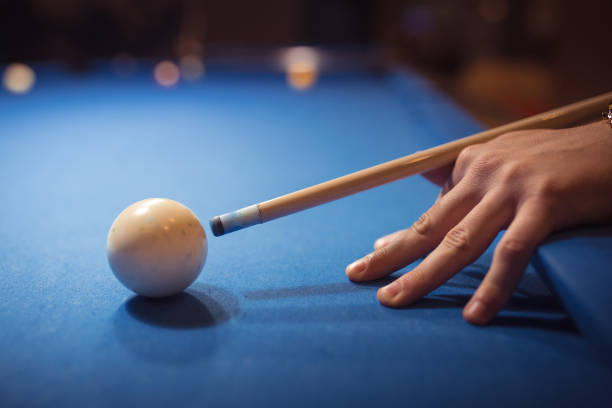playing billiards - pool cue stock photos and pictures