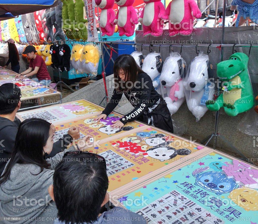Playing Bingo at an Outdoor Market stock photo