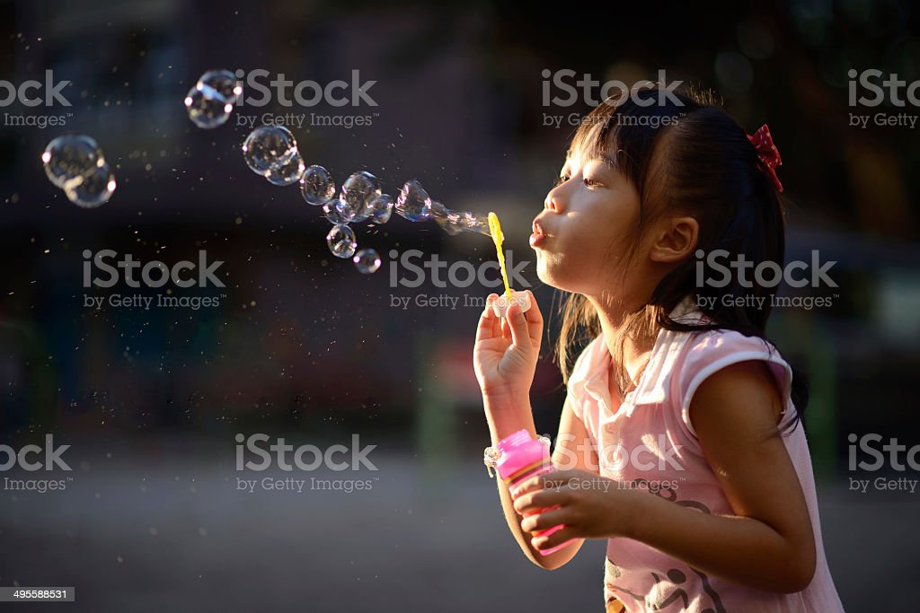 playing bubble wand file_thumbview_approve.php?size=3&id=41101340 Asian and Indian Ethnicities Stock Photo