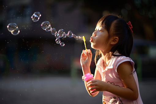 Playing Bubble Wand Stock Photo - Download Image Now