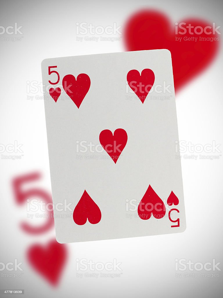 Playing card, five of hearts stock photo