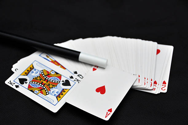 Playing card with magic wand Playing card with magic wand on a black background magic trick stock pictures, royalty-free photos & images