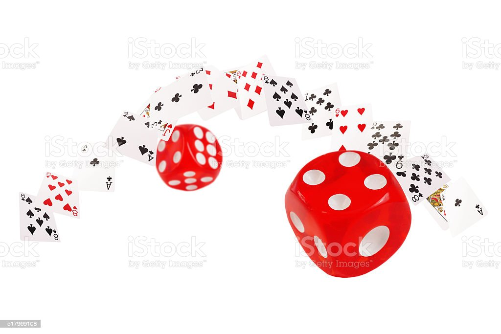 Playing cards and dice flying  on white background stock photo